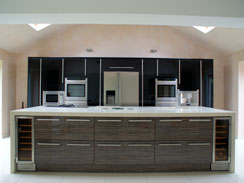 A high gloss mix kitchen with central island and corian wrap around