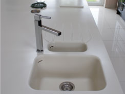 A close up image of the corian worktop with the 1.5 bowl moulded sink