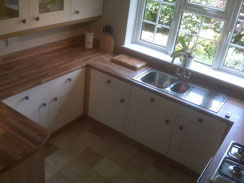 A solid oak hand painted shaker style kitchen